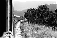 A train heading south to Greece. This passenger train from Budapest to Thessaloniki runs through the heart of former Yugoslavia. Southern Macedonia, June 1998 &copy; Stephen Blake Farrington<br />