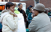 Chicago, IL - November 26, 2008 -- Two women react to seeing United States President-elect Barack Obama, center, pass out food at St. Columbanus Parrish and School Wednesday, November 26, 2008, in Chicago, Illinois. .Credit: Frank Polich - Pool via CNP