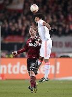 FUSSBALL   1. BUNDESLIGA  SAISON 2012/2013   12. Spieltag 1. FC Nuernberg - FC Bayern Muenchen      17.11.2012 Sebastian Polter (li, 1 FC Nuernberg) gegen Dante (FC Bayern Muenchen)