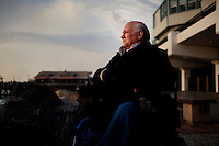 "Redondo Beach, California, December 15, 2011 – A portrait of author and anti-war activist Ron Kovic near the Redondo Beach Pier a few blocks from where he lives. He says he loves the pier and visits often. Kovic is best known as the author of the memoir Born on the Fourth of July, which was made into an Academy Award–winning movie directed by Oliver Stone, with Tom Cruise playing Kovic. He received the Golden Globe Award for Best Screenplay on January 20, 1990, exactly 22 years to the day that he was wounded in Vietnam and was also nominated for an Academy Award for best screenplay. Kovic, who volunteered and served for two tours in Vietnam, was shot through the chest and foot leaving him paralyzed from the chest down. His politics about the war began to change after the shootings at Kent State. He spoke at rallies opposing the war and was arrested 12 times for political protest, including a famous interruption of the 1972 Republican National Convention. In 1974 he led a hunger strike protesting the poor treatment of injured veterans returning from the war and was instrumental in changing conditions in the country's Veterans Affairs facilities. He has since worked to help returning veterans, VA conditions and as an anti-war spokesman. ..Kovic remains upbeat and a force to be reakoned with, despite his adversity. He says his doctors told him early on that he wouldn't live to 30. ""I proved them wrong,"" says Kovic. Adding that his tragedy has been a blessing in that it has led him on a mission on behalf of peace."