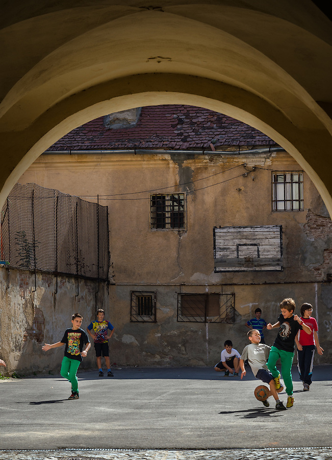 BRASOV, ROMANIA - October 2, 2012: Local kids playing soccer in the streets of Bra?ov, Romania, with 227,961 people living there is the 8th most populous city in Romania and a popular tourist destination.