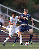 Boston College defender/forward Kevin Mejia (12) dribbles as Quinnipiac University forward Nils von der Heide (7) defends. Boston College defeated Quinnipiac, 5-0, at Newton Soccer Field, September 1, 2011.