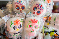 Sugar skull candies for Halloween are displayed in a FAO Schwarz in New York on Thursday, October 16, 2014. According to the National Confectioners Association sales of Halloween candy is expected to reach $2.5 billion in the U.S. Chocolate is the number one seller followed closely by candy corn. (© Richard B. Levine)