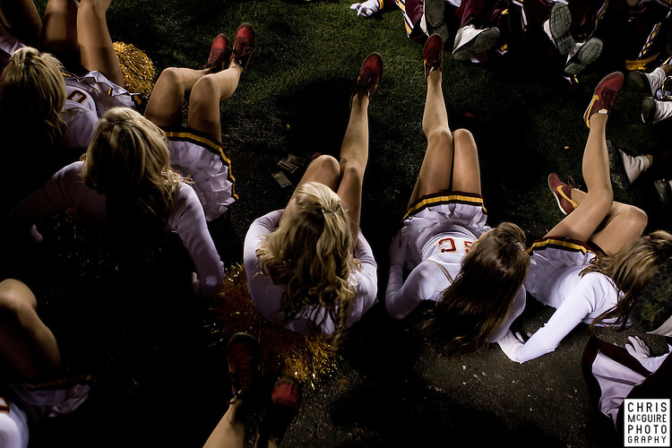"10/17/09 - South Bend, IN:  The USC song girls dance to the USC Trojan Marching Band's rendition of ""Animal House"" during the postgame show at Notre Dame Stadium on Saturday.  USC won the game 34-27 to extend its win streak over Notre Dame to 8 games.  Photo by Christopher McGuire."