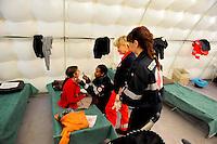 Roma 28 Febbraio 2009.Prima campagna di vaccinazione della Croce Rossa Italiana riguardante i bambini del campo nomadi Casilino 900, uno dei più grandi della Capitale..I medici della Croce Rossa Italiana visitano i bambini rom