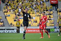 Ref gives a Yellow Card during the A League - Wellington Phoenix v Adelaide United, Wellington, New Zealand on Sunday 30 March 2014. <br /> Photo by Masanori Udagawa. <br /> www.photowellington.photoshelter.com.