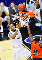 Charles Okwandu of the Huskies beats his man to the basket for two points. Connecticut defeated Bucknell 81-52 during the NCAA tournament at the Verizon Center in Washington, D.C. on Thursday, March 17, 2011. Alan P. Santos/DC Sports Box