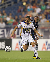 Pumas UNAM forward Juan Francisco Palencia (17) breaks for the net with New England Revolution defender Darrius Barnes (25) in pursuit. The New England Revolution defeated Pumas UNAM in SuperLiga group play, 1-0, at Gillette Stadium on July 14, 2010.