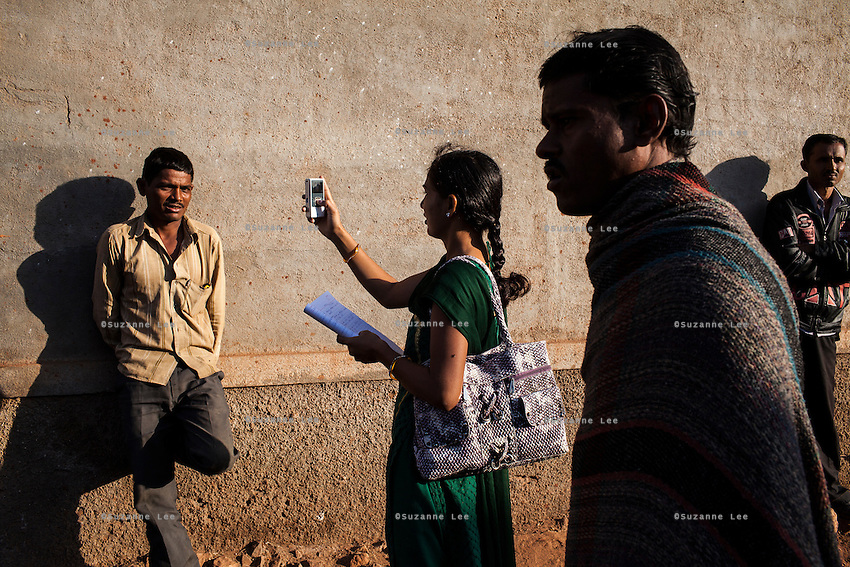 Video Volunteer videojournalist Niru J. Rathod, 24, does spot interviews with villagers on topics of caste discrimination and water quality issues in a remote village in Surendranagar, Gujarat, India on 14 December 2012. Niru, the 8th child in a family of 11 girls born to a Dalit construction worker, has been using videography for social change since 2006. She shoots and produces her own short documentaries and is a committed video activist, having conducted hundreds of village video screenings where she also speaks to thousands of men, shattering their ideas about what a woman and a Dalit can do while bringing massive changes to the communities she documents. Photo by Suzanne Lee / Marie Claire France