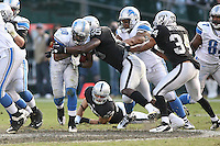 December 18, 2011 Oakland, CA: Detroit Lions running back Kevin Smith #30 and Oakland Raiders middle linebacker Rolando McClain #55 during an NFL game played between the Oakland Raiders and the Detroit Lions at O.co Coliseum. The Lions defeated the Raiders 28-27.