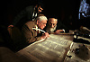 Milton Feldman, left, watches where Rabbi Moshe Klein, right wants hi to fill in the letters to the last word of the Torah while Rabbi Fishel Zaklos watches at the Ritz Carlton in Naples Sunday night. Rabbi Zaklos, leader of the Chbad of Naples held the dedication of their new Torah at the hotel to a crowd of more than 300. For more photos go to naplesnews.com. Erik Kellar/Staff