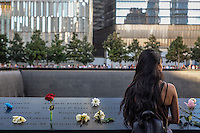 NEW YORK, NY - SEPTEMBER 11, 2016: A girl looks over the north memorial pool at the 9/11 Memorial and Museum during the 15th anniversary of the 9/11 attacks on September 11, 2016 in New York. Photo by (VIEWpress/Maite H. Mateo)