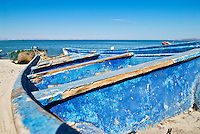 Brightly colored old fishing boat sitting on beach, La Paz, Baja