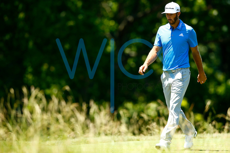 Dustin Johnson walks to the fairway after teeing off on the 17th hole during the 2016 U.S. Open in Oakmont, Pennsylvania on June 17, 2016. (Photo by Jared Wickerham / DKPS)