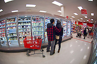 Shoppers in a frozen food aisle in the grocery department in a Target store in Elmhurst in the New York borough of Queens during the Thanksgiving weekend, on Saturday, November 26, 2011. (© Richard B. Levine)