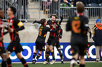 Maryland Terrapins forward Patrick Mullins (15) celebrates scoring with teammates during the championship match of the division 1 2013 NCAA  Men's Soccer College Cup at PPL Park in Chester, PA, on December 15, 2013.
