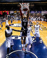 INDIANAPOLIS, IN - FEBRUARY 19: Andre Marhold #0 of the Duquesne Dukes dunks the ball against the Butler Bulldogs at Hinkle Fieldhouse on February 19, 2013 in Indianapolis, Indiana. Butler defeated Duquesne 68-49. (Photo by Michael Hickey/Getty Images) *** Local Caption *** Andre Marhold