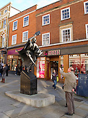 """The Surrey Scholar"".  Sculpture by Allan Sly FRBS (www.allansly.co.uk) in the High Street, Guildford, Surrey.  Presented to the borough to celebrate Guildford as a place of culture and scholarship by Professor Patrick Dowling, Vice Chancellor, on behalf of the University of Surrey, May 2002."