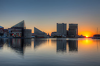 The rising sun brings a new day to the waters of the Patapsco River flowing in the Inner Harbor in Baltimore, Maryland.