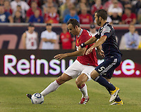 Manchester United FC forward Dimitar Berbatov (9) passes the ball as New England Revolution defender A.J. Soares (5) defends. In a Herbalife World Football Challenge 2011 friendly match, Manchester United FC defeated the New England Revolution, 4-1, at Gillette Stadium on July 13, 2011.