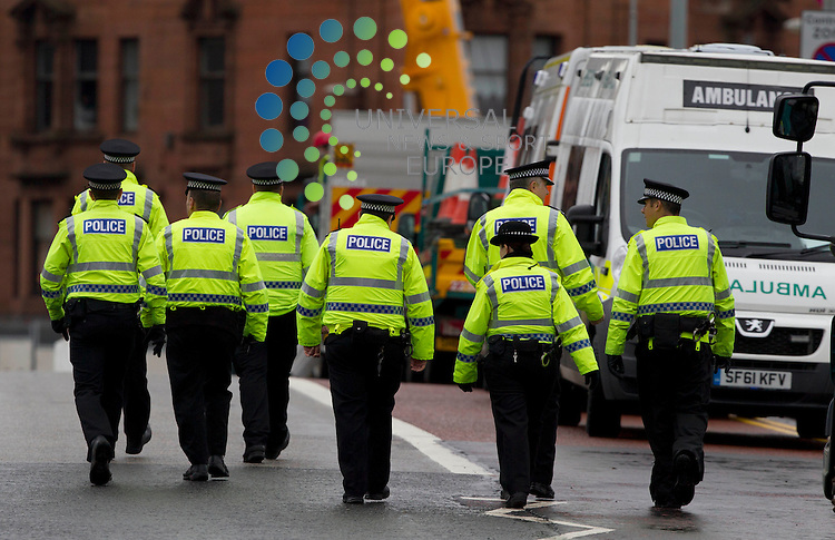 Joint aircraft recovery take the police helicopter away which crashed into a busy Glasgow pub killing at least nine people.<br /> The wreckage of the Police Scotland aircraft was winched from The Clutha, where it came down at 22:25 on Friday.<br /> Police Scotland have said they cannot rule out finding more bodies.<br /> The three helicopter crew died in the incident along with six people inside the pub. Police have released the names of five of the victims. Efforts to identify other fatalities continue.<br /> Samuel McGhee, 56, of Glasgow, is the second of six people who died in the bar to be named. The three helicopter crew members were named on Sunday. <br /> Picture: Maurice McDonald/Universal News And Sport (Europe) 2 December  2013