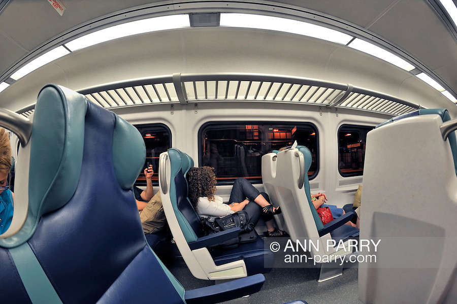 lirr interior of train car with several passengers stopped at penn station nyc before going. Black Bedroom Furniture Sets. Home Design Ideas