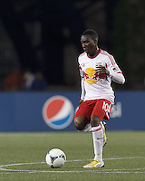 New York Red Bulls midfielder Lloyd Sam (10) at midfield. In a Major League Soccer (MLS) match, the New England Revolution (blue) tied New York Red Bulls (white), 1-1, at Gillette Stadium on May 11, 2013.