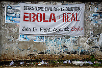 A sign warning about ebola in the streets of central Freetown.