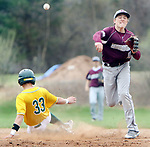 WATERBURY CT. 19 April 2017-041817SV10-#10 Derrick Jagello of Naugatuck High got #33 Brian Parzyck of Holy Cross High at 2nd and made the throw to 1st for the double play during NVL baseball action in Waterbury Wednesday.<br /> Steven Valenti Republican-American