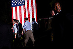 Republican vice presidential candidate Rep. Paul Ryan rolls his sleeves up as he leaves a campaign rally in Fort Myers, Florida, October 18, 2012.