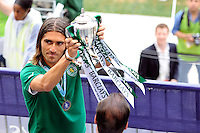 Pedro Mendes (6) of Sporting Clube de Portugal shows the trophy to the fans. Tottenham Hotspur F. C. and Sporting Clube de Portugal played to a 2-2 tie during a Barclays New York Challenge match at Red Bull Arena in Harrison, NJ, on July 25, 2010.