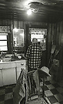 """December 1971:  Modesto, California—Dad Walkling— Dad in his kitchen.  I first met Orlando """"Dad"""" Walkling at his house in the airport district of Modesto just before his 104th birthday.  Walkling was born in Indian Territory January 2, 1868, near a town now called McAlester, Oklahoma.  His mother was Shawnee and his father, whom he didn't remember, was an Englishman named Orlando.  He later used the name Walkling instead of his Indian name of Skipocase.  On September 16, 1893, Skipocase O. Walkling, then 25 years old, was among thousands of settlers who rode into the Cherokee Strip Land Run of Oklahoma to make a free land claim.  Walkling told of how he rode into the 226-mile long """"Strip"""" to claim 160 acres.  """"There were thousands of men who waited at the line until noon that day.  The army gun was fired and chaos broke out. Every man carried a gun. There was no law, no sheriff, nothing.  People had to fight for their claim even though they were first.""""  Walkling made a claim, but later gave it up when he had a chance to farm a piece of land in Noble County, Oklahoma.  He cleared the land with six yoke of oxen and planted peach orchards.  He and his first wife ran a combination grocery store and hotel there.  He had nearly 1,000 trees and began a cannery to process the crops.  """"One day when the train came in a woman dressed like a Salvation Army woman handed me a bundle as I stood on the ramp, then she jumped back into the train.  I opened it and there was a pair of twins, a boy and a girl,"""" Walkling said.  He and his wife did not have children, so they adopted the twins legally and raised them.  He said they raised six others but did not adopt them.  He came to Modesto in 1944 at 76 years of age and went to work for a meat firm before he opened a poultry store.  After that store closed, he made bullwhips and wove rope for truckers at his home.  In 1968, Dad Walking, then 100 years old, visited Oklahoma for the 75th anniversary of the Running of the Cherok"""