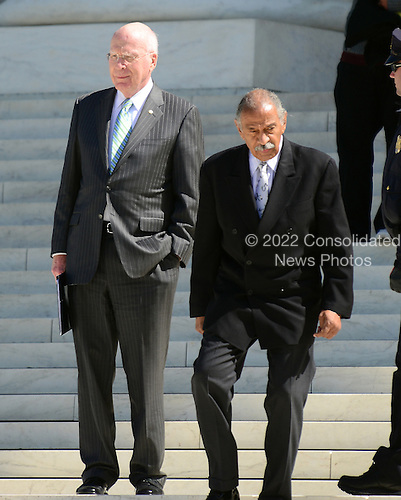 United States Senator Patrick Leahy (Democrat of Vermont), Chairman, U.S. Senate Judiciary Committee, left, and U.S. Representative John Conyers (Democrat of Michigan), Ranking Member, U.S. House Judiciary Committee, right, depart the U.S. Supreme Court Building following the second day of oral arguments concerning the Constitutionality of the U.S. Health Care Law.  .Credit: Ron Sachs / CNP