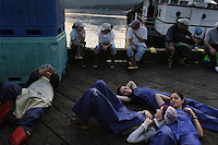 Cannery workers take a break during the busiest part of the salmon season.  Icelandic seafood employs hundreds of seasonal employees--some are foreigners only in Alaska for the summer while others are students trying to earn some quick money,  It is tiring work with long hours.