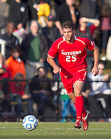 Boston College defender Jamie Doherty (25) brings the ball forward.  Rutgers University defeated Boston College in penalty kicks after two overtime periods in NCAA Division I tournament action, at Newton Campus Field, November 20, 2011.