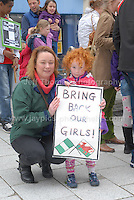 Young supporter Olwyn Lloyd makes her statement along with her Mam at the rally.<br /> <br /> Cardiff, South Wales. Sunday May 11th 2014. Nigerians in Cardiff in organised rally in support of the 276 abducted school children in Chibok, Nigeria by Boko Haram terrorists. <br /> <br /> Photo by Jeff Thomas/Jeff Thomas Photography