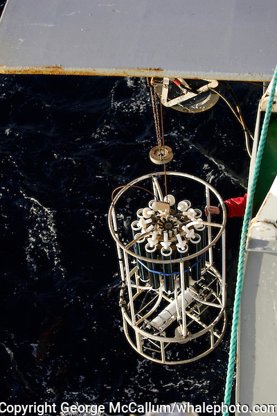 Conductivity, ( salinity ) Temperature, And water sampling Sonde being lowered into Barents sea to take oceanographic measurements.