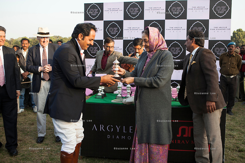 Her Highness Rajmata Padmini Devi of Jaipur presents a trophy to Maharaj Narendra Singh (left) of the Jaipur royal family, and the captain of the Royal Jaipur Polo Team after they win a close match for the Argyle Pink Diamond Cup, organised as part of the 2013 Oz Fest in the Rajasthan Polo Club grounds in Jaipur, Rajasthan, India on 10th January 2013. Photo by Suzanne Lee