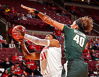 Ohio State Buckeyes guard Raven Ferguson (31) has her shot blocked by Michigan State Spartans center Madison Williams (40) during the first half of their NCAA basketball game at Value City Arena in Columbus, Ohio on January 26, 2014.  (Dispatch photo by Kyle Robertson)