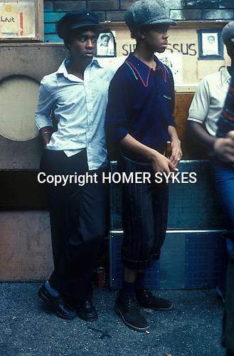 Notting Hill Carnival 1976 London. Black teens listening to music.