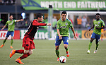 Seattle Sounders Gonzalo Pineda (8) and  Portland Timbers Jorge Villafana (19) moves towards a ball during an MLS match on April 26, 2015 at CenturyLink Field in Seattle, Washington.  Seattle Sounders Clint Dempsey scored a goal to give the Sounders a 1-0 victory over the Timbers. Jim Bryant Photo. ©2015. All Rights Reserved.