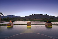 Evening view across swimming pool towards mountains