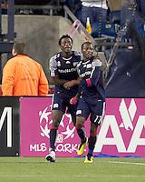 New England Revolution midfielder Kenny Mansally (7) celebrates his goal with New England Revolution midfielder Sainey Nyassi (17). Real Salt Lake defeated the New England Revolution, 2-1, at Gillette Stadium on October 2, 2010.
