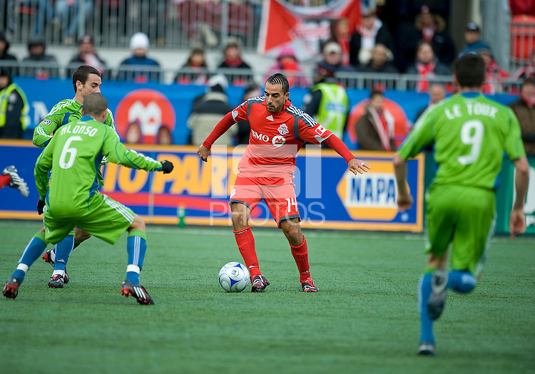 Dewayne DeRosario (14) of Toronto FC in his first home game appears to be surrounded by Seattle players during MLS action against the Seattle Sounders FC at BMO Field on April 4, 2009. Seattle won 2-0.