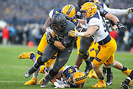 Baltimore, MD - December 10, 2016: Army Black Knights running back Darnell Woolfolk (33) gets tackled by several Navy Midshipmen defenders during game between Army and Navy at  M&T Bank Stadium in Baltimore, MD.   (Photo by Elliott Brown/Media Images International)
