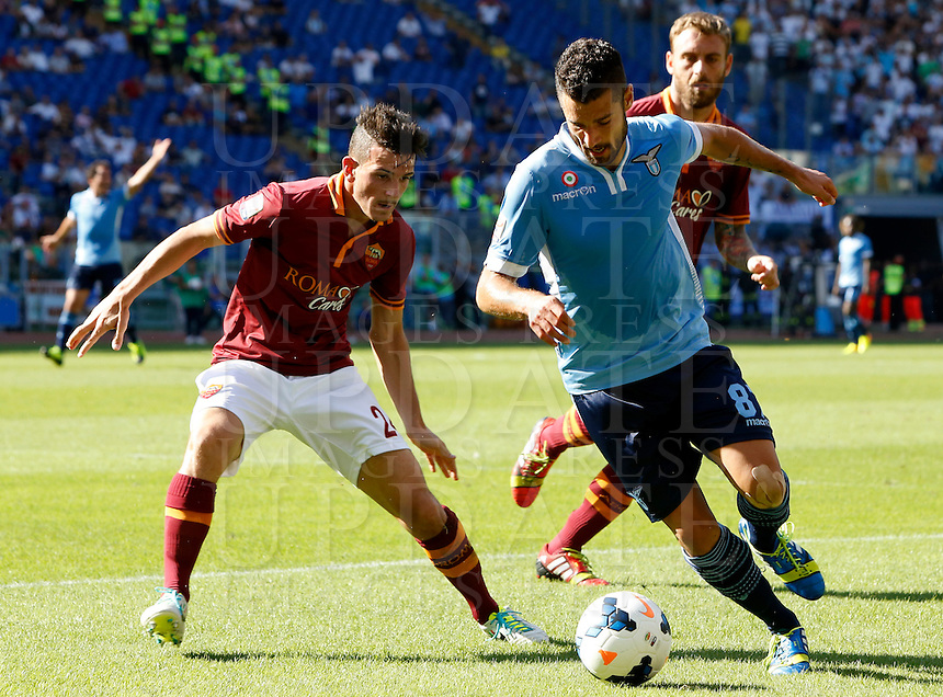 Calcio, Serie A: Roma vs Lazio. Roma, stadio Olimpico, 22 settembre 2013.<br /> Lazio midfielder Antonio Candreva, right, is challenged by AS Roma midfielder Alessandro Florenzi during the Italian Serie A football match between AS Roma and Lazio, at Rome's Olympic stadium, 22 September 2013.<br /> UPDATE IMAGES PRESS/Riccardo De Luca