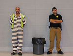 Sam Owens and his corrections officer Billy King take a short break while setting up for an auction at Laurel-London Optimist Club, a nonprofit activity center for children. The inmates generally work there Monday through Friday on work release. Their tasks can include  cleaning up the gym after a game or repainting the soccer and baseball fields..Photo by Amanda Powell