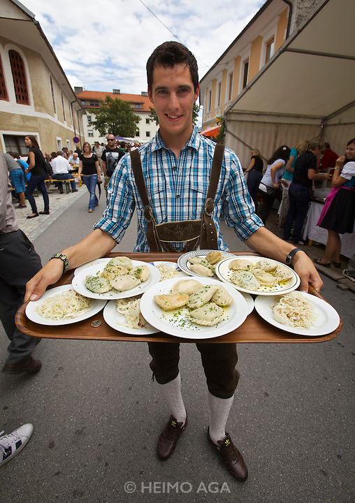 "Kärntnernudelfest (Carinthian Dumplings Festival) in Oberdrauburg 2011. A local in ""Lederhosen"" with Kasnudeln for all his friends."