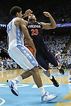 16 February 2013: North Carolina's James Michael McAdoo (43) receives a cut in his lip from this collision with Virginia's Justin Anderson (23). The University of North Carolina Tar Heels played the University of Virginia Cavaliers at the Dean E. Smith Center in Chapel Hill, North Carolina in a 2012-2013 NCAA Division I and Atlantic Coast Conference men's college basketball game. UNC won the game 93-81.