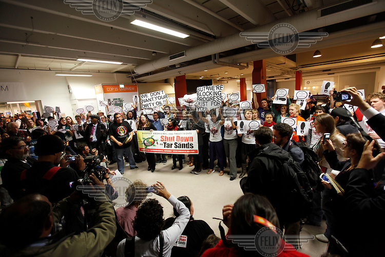 Protest inside the Bella Center. United Nations Climate Change Conference (COP15) was held at Bella Center in Copenhagen from the 7th to the 18th of December, 2009. A great deal of groups tried to voice their opinion and promote their cause in various ways. The conference and demonstrations was covered by thousands of photographers and journalists from all over the world...©Fredrik Naumann/Felix Features.